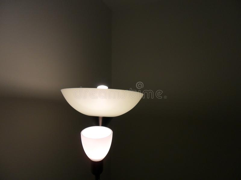 Floor lamp with black wall royalty free stock image