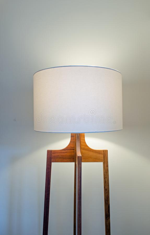 Floor lamp with white cover. In the corner royalty free stock images