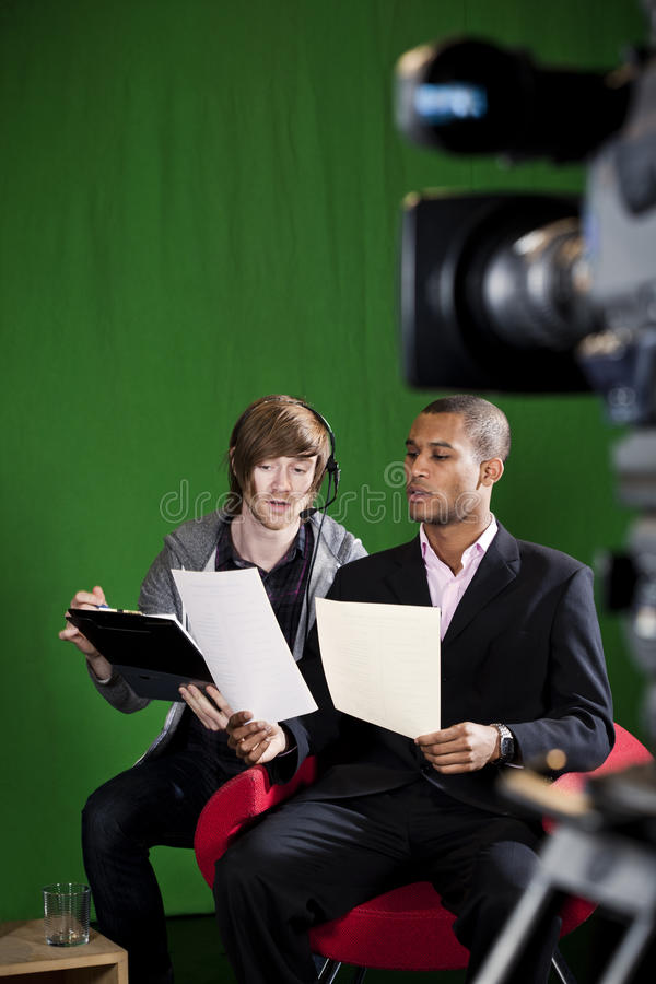 Floor Manager Briefing Presenter In Tv Studio Stock Image
