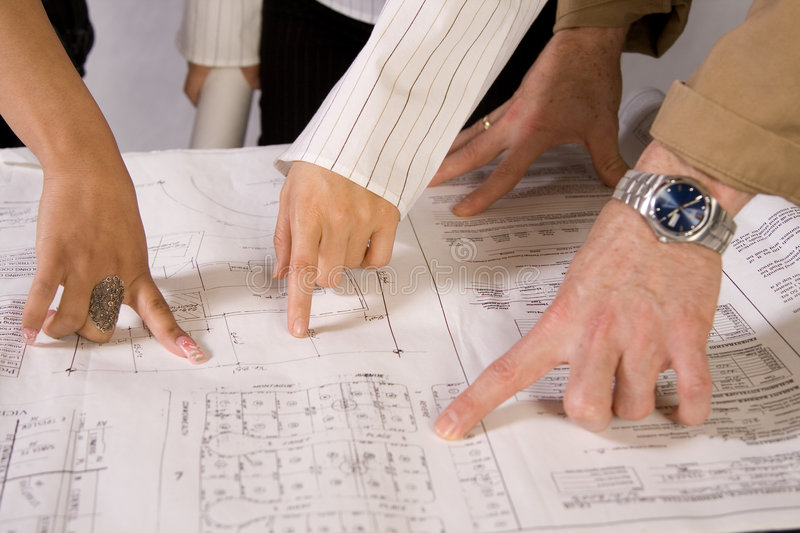 Floor plan. Finger pointing to the floor plan of a building royalty free stock image