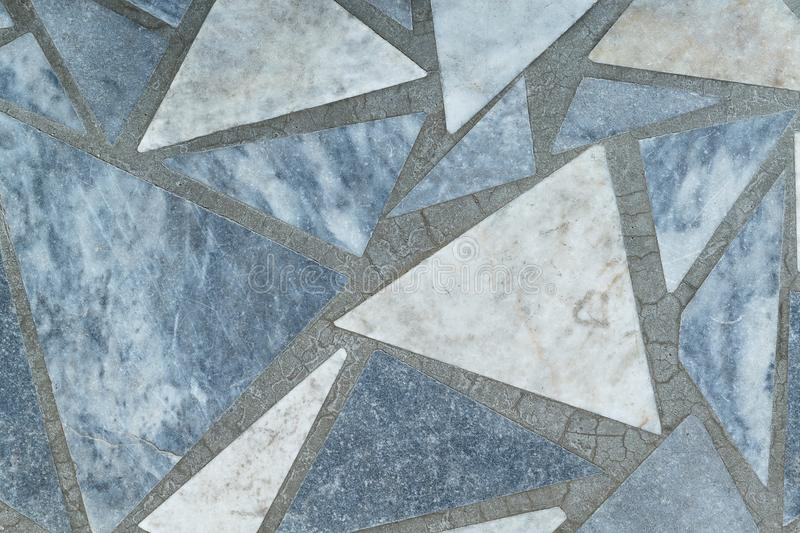 Floor or surface lined with marble slabs of triangular form. stock photos