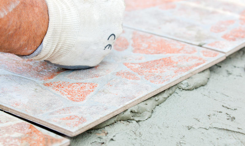 Floor Tile Installation stock images