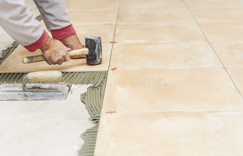 Floor tile installation stock photo