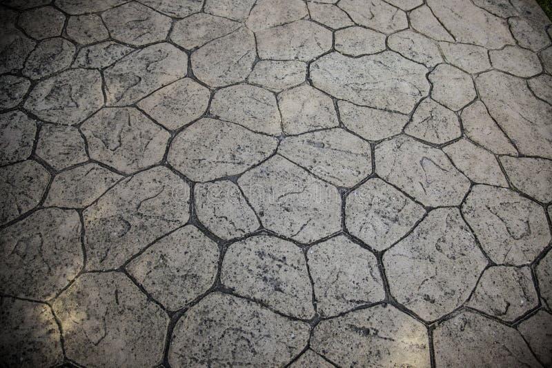 Floor tile street. Flooring stone floor tiles in city street, construction, texture, paving, sidewalk, background, pattern, pavement, cement, block, brick, rough royalty free stock photos