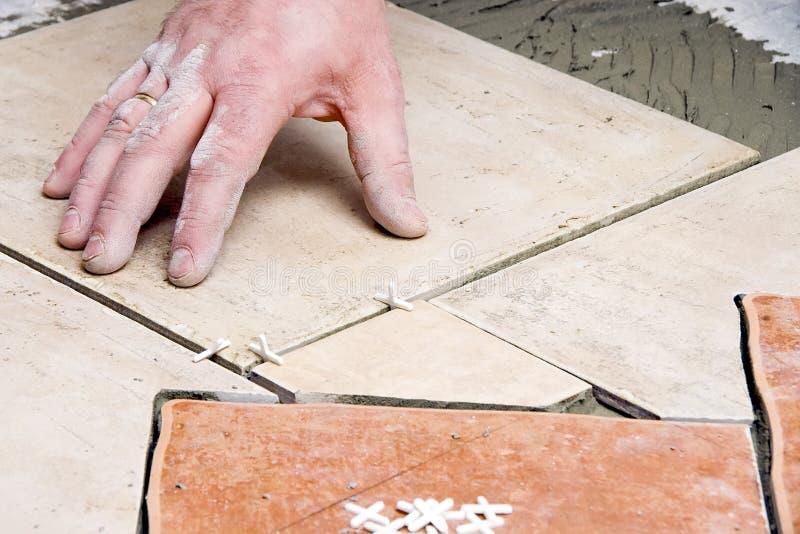 Floor tiles installation royalty free stock photo