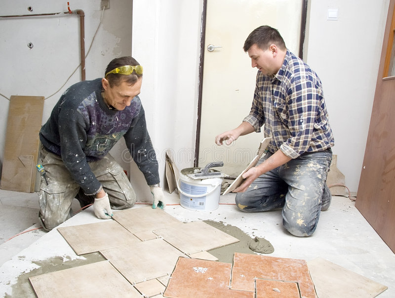 Floor tiles installation stock images