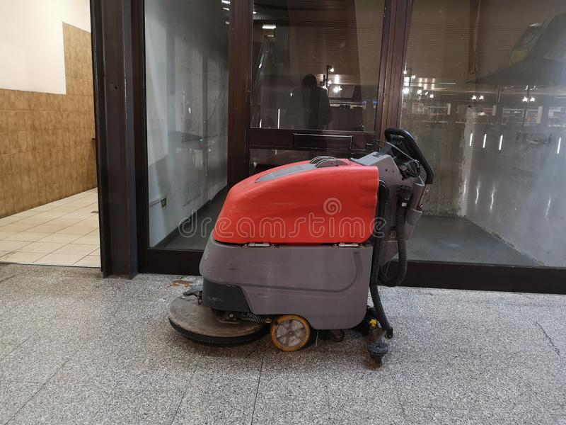 Floor washers in the corridor. Red stock photography