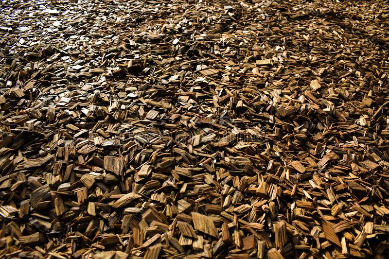 Wood Chips Flakes Chunks Pieces Brown Gold Sunshine Decoration P. A floor of wooden flakes in a playground which can be used as a cool background royalty free stock images