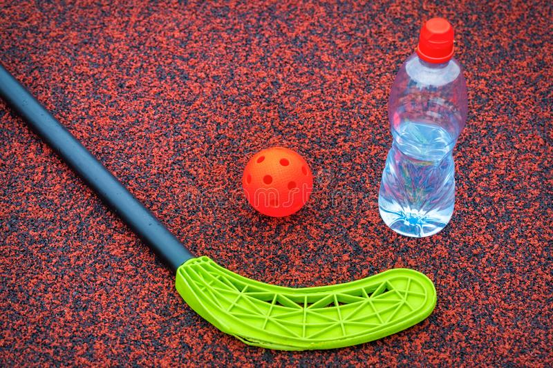 Floorball ball near stick and water bottle stock image