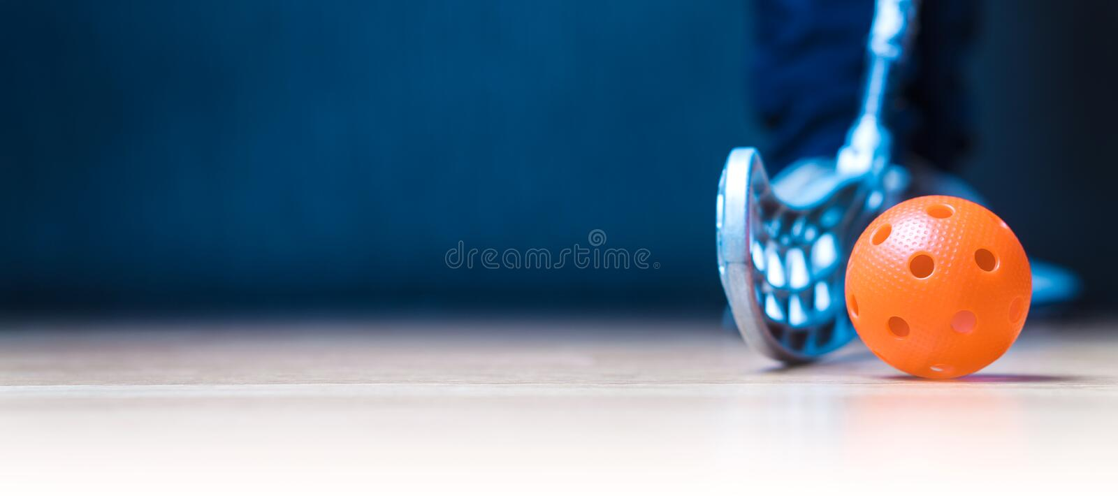 Floorball banner with ball, stick and player. Floor hockey concept. Negative copy space stock photography