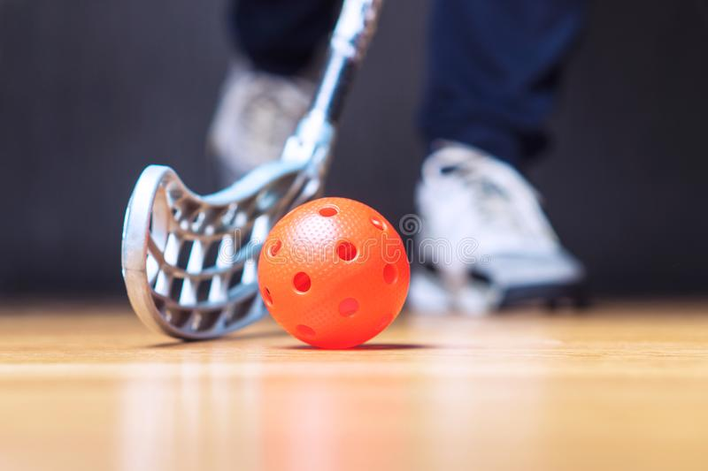 Floorball player with stick and ball. Floor hockey. Floorball player with stick and ball. Floor hockey concept royalty free stock image