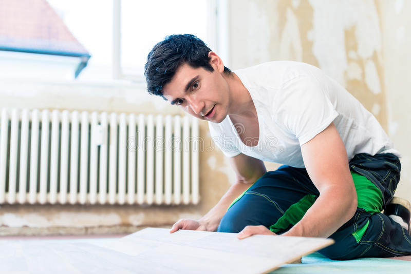 Floorer working in home in improvement project stock image