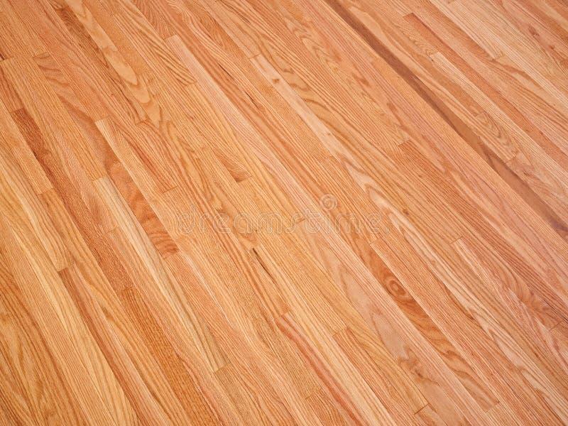 Flooring. Wide area shot of newly finished oak hardwood flooring royalty free stock photography
