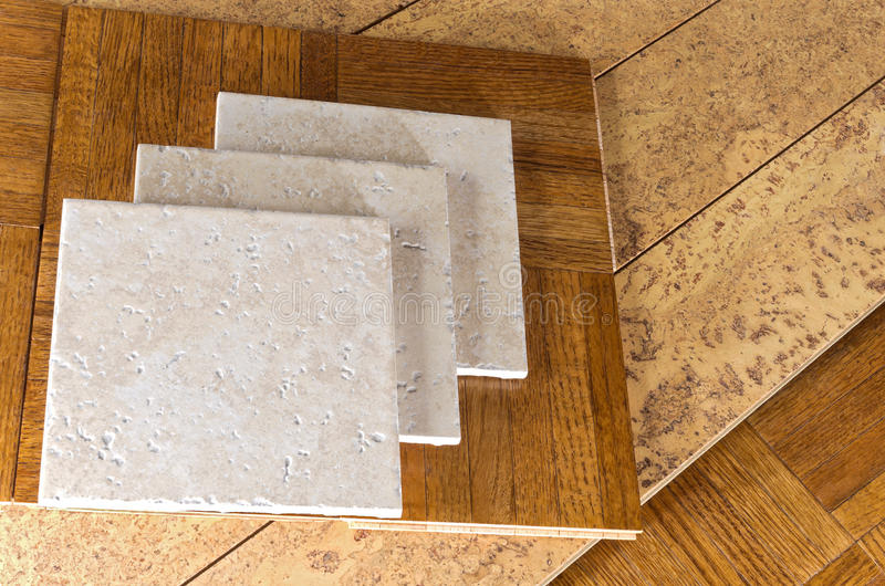 Flooring Samples of Wood, Cork and Tile. Ceramic tile, cork and parquet wooden flooring samples for home interior remodel stock photography