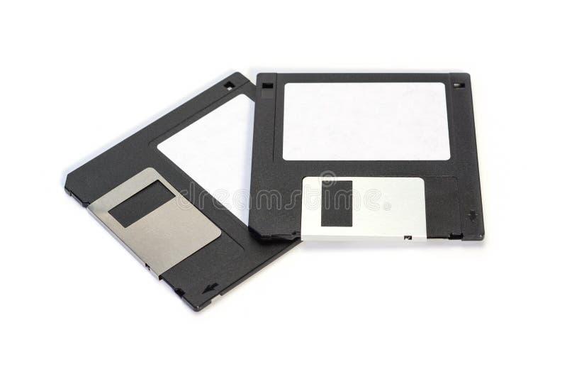 Floppy disk 3 A 5 pollici isolato su backround bianco Vista frontale d'annata del dischetto di computer due fotografie stock