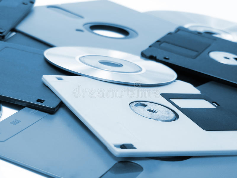 Floppy disks. Background with floppy disks and optical discs royalty free stock photos