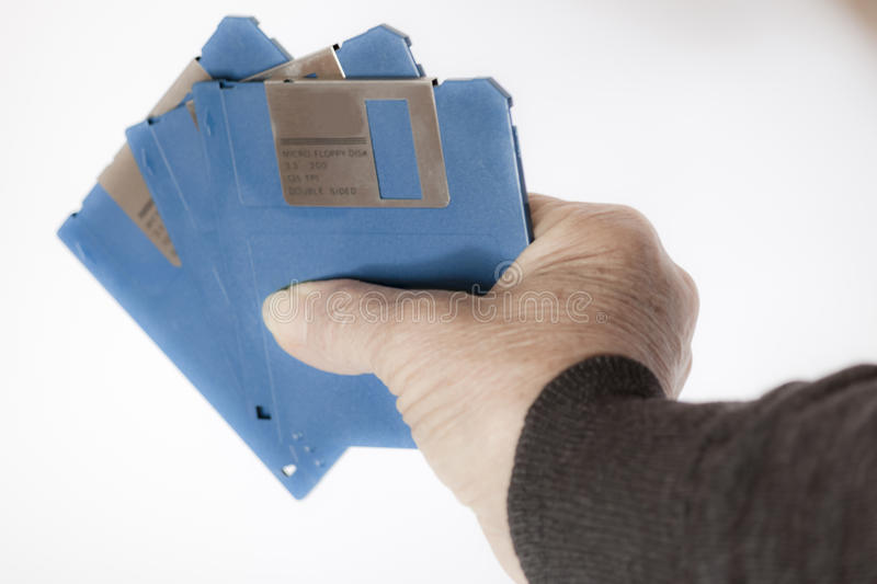Floppy disks in the hand stock photos
