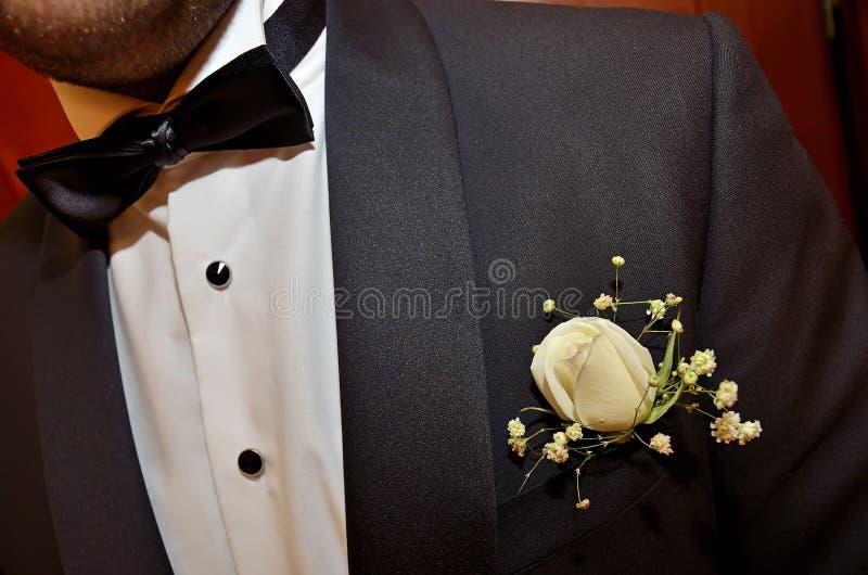Flor branca do bolso do noivo fotografia de stock