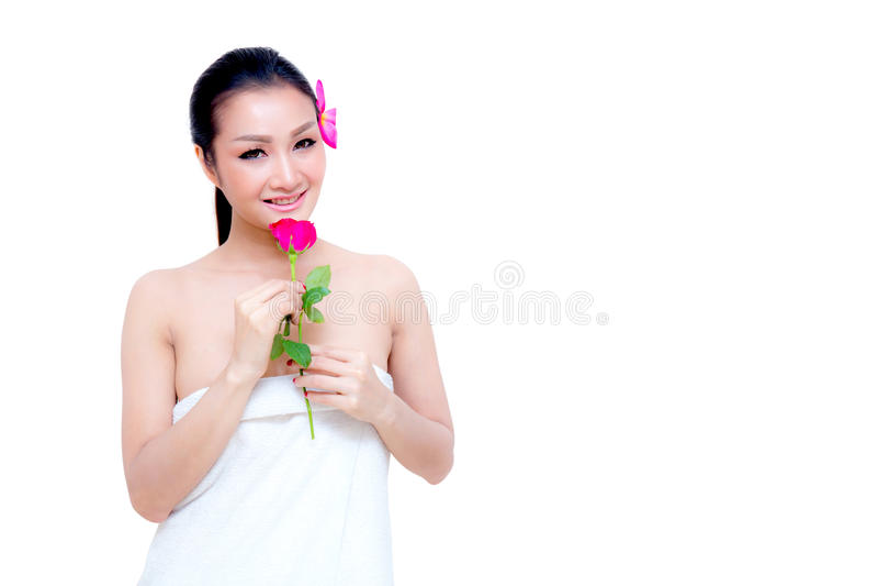 flor cor-de-rosa da posse bonita de toalha do desgaste de mulher foto de stock royalty free