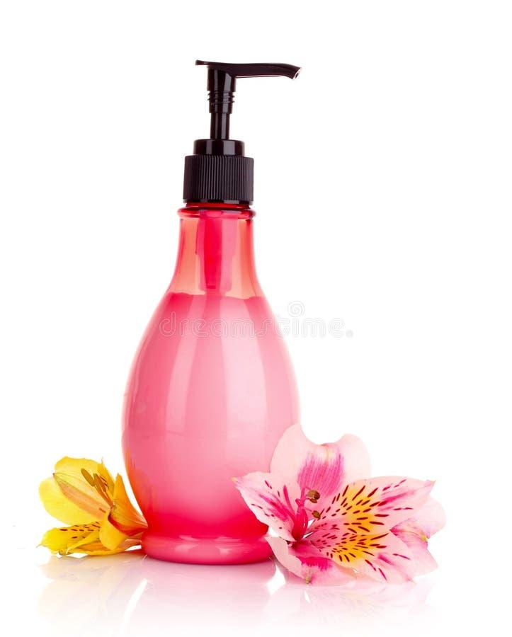 Flor e sabão líquido isolados fotografia de stock royalty free