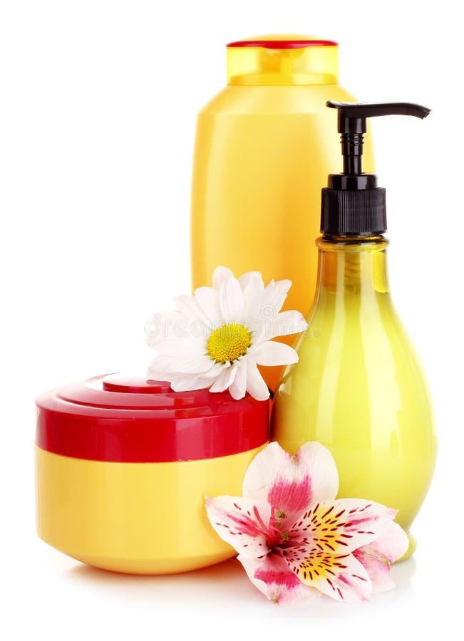 Flor e sabão líquido isolados imagens de stock