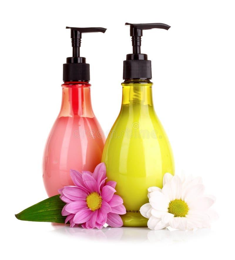 Flor e sabão líquido isolados imagem de stock royalty free