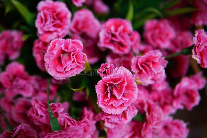 Flor falsa y fondo floral fotos de archivo libres de regalías