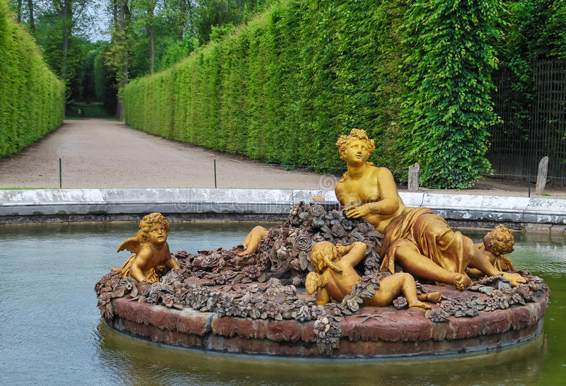 Flora fountain in Versailles Palace garden, France. Golden statue of flora in Versailles Palace garden, France stock photos