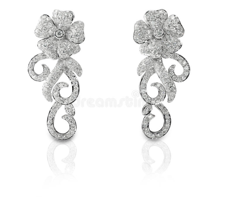 Floral που διαμορφώνεται στρώνει τα σκουλαρίκια διαμαντιών στοκ φωτογραφία με δικαίωμα ελεύθερης χρήσης
