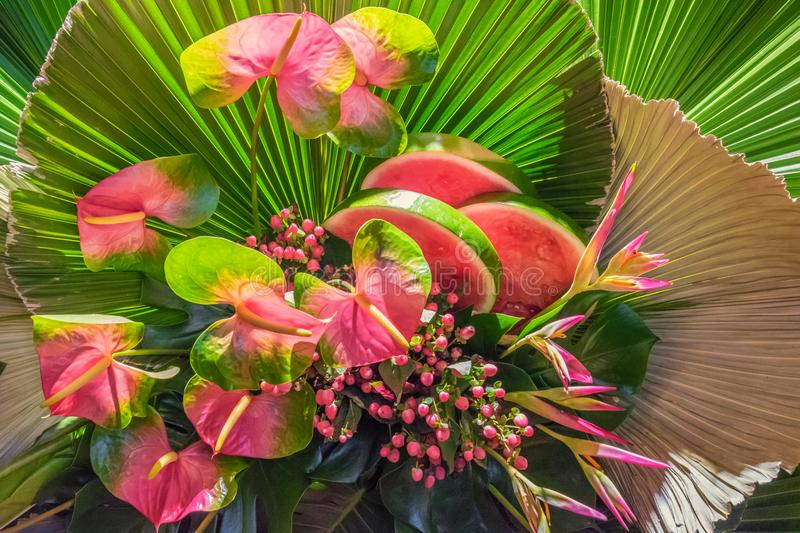 Floral arrangement with watermelons royalty free stock images