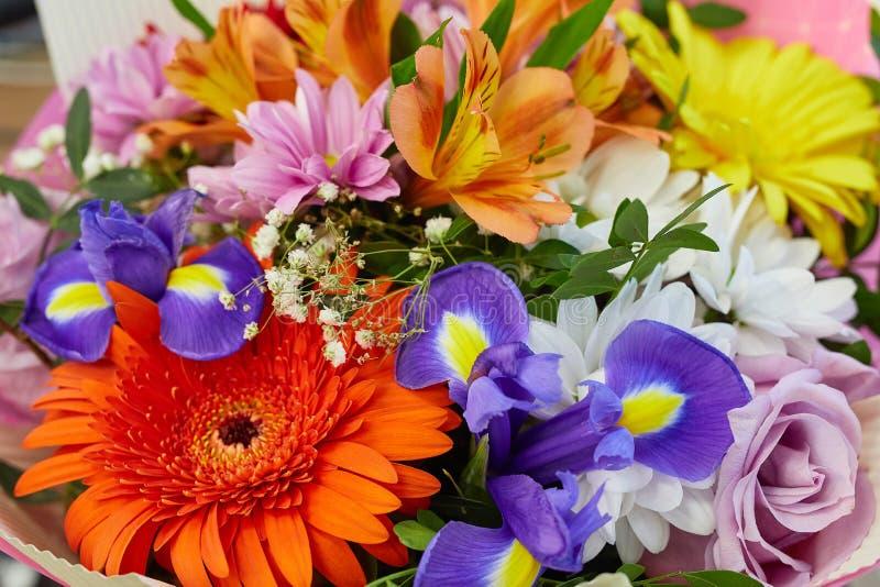 Floral bouquet of colorful bright flower. floristic arrangement closeup. gerbera, rose, irises, orange alstroemeria stock images