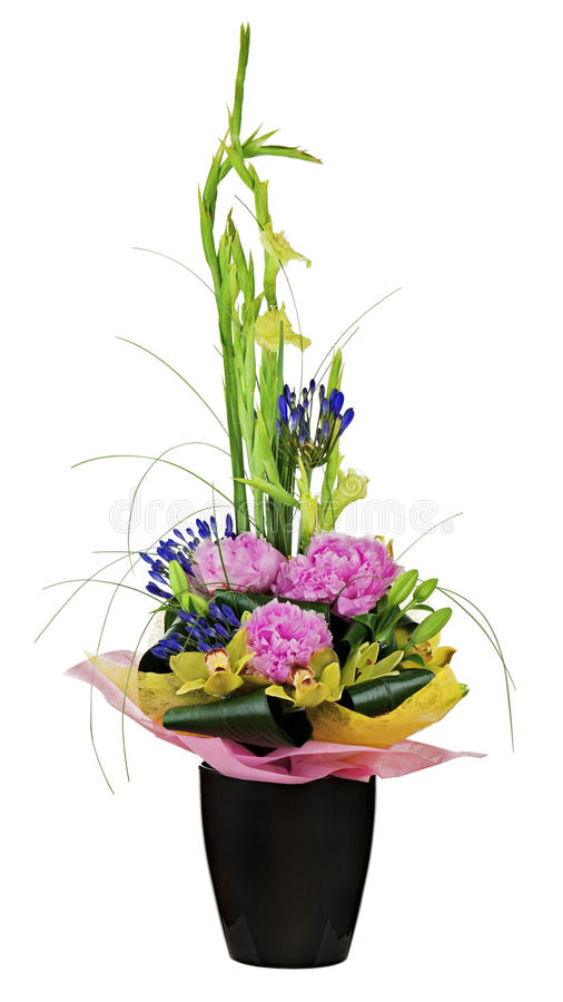 Floral bouquet of orchids, peon flowers and gladiolus arrangement centerpiece in vase isolated on white background. stock photo