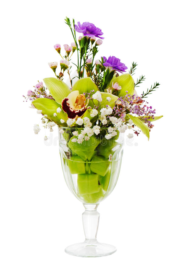 Floral bouquet of orchids, roses and carnation arrangement centerpiece in glass vase isolated on white background stock photography