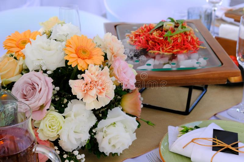 Floral bouquet and salad on a decorated banquet table in luxury restaurant. Floral bouquet and salad on a decorated banquet table in a luxury restaurant royalty free stock photos