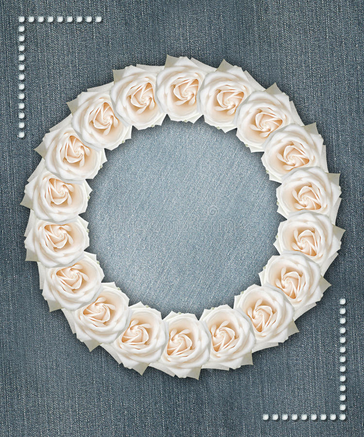 Floral circular frame with denim background. Floral frame with denim background and angle motifs royalty free stock photo