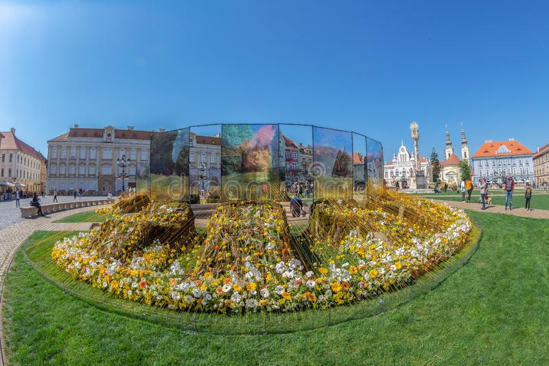 Floral decorations in Timisoara, Romania. TIMISOARA, ROMANIA - APRIL 20, 2019: Beautiful floral decoration with the name 10.000 smiles in Union Square on the stock photo