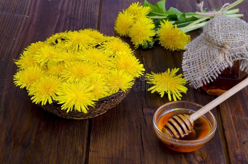 Floral delicious honey from dandelions. Studio Photo stock image