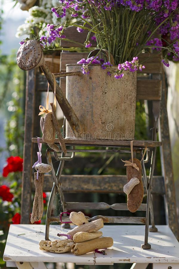 Floral and driftwood decoration crafts. In a urban garden royalty free stock images