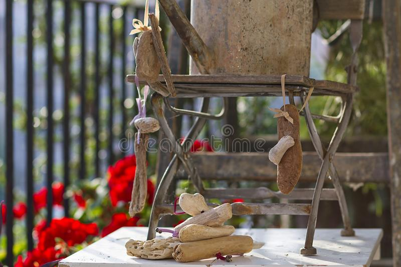 Floral and driftwood decoration crafts. In a urban garden royalty free stock photos