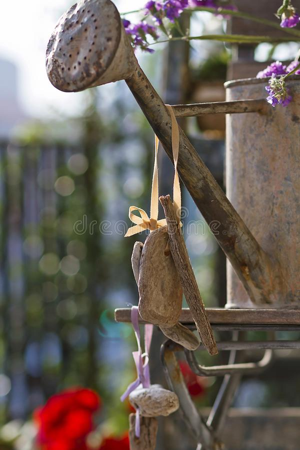 Floral and driftwood decoration crafts. In a urban garden royalty free stock photography