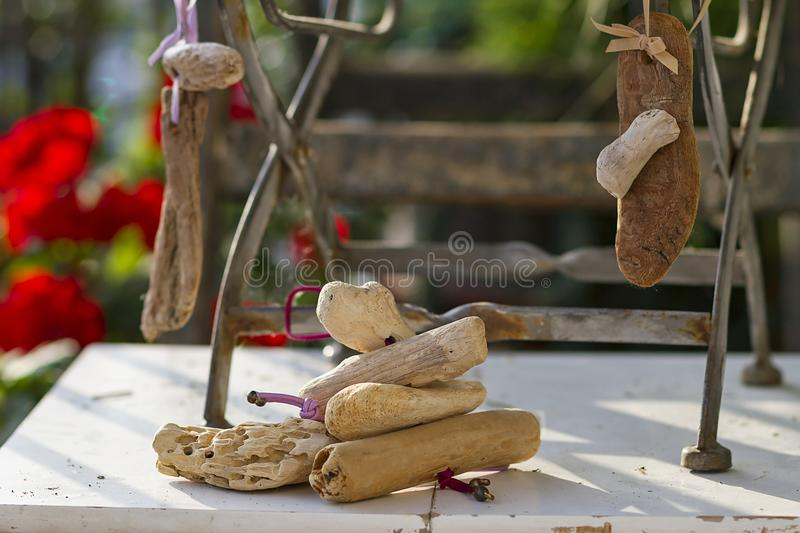 Floral and driftwood decoration crafts. In a urban garden stock photography