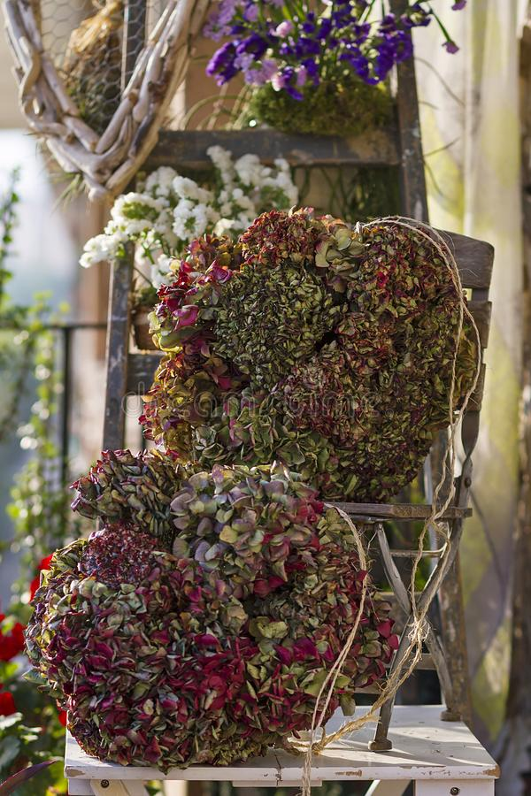 Floral and driftwood decoration crafts. In a urban garden stock photos