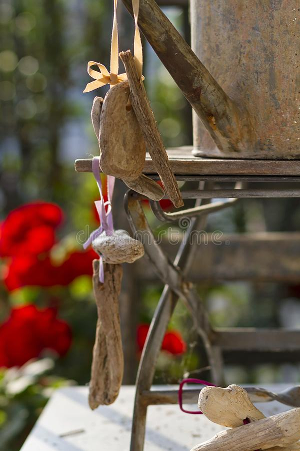 Floral and driftwood decoration crafts. In a urban garden stock images