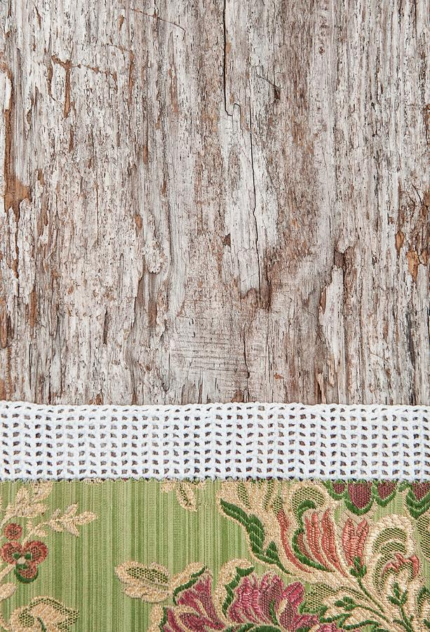 Floral fabric and lace on old wood background. Floral fabric and lace on the old wood background stock image