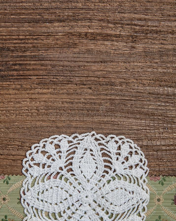 Floral fabric and lace on old wood background. Floral fabric and lace on the old wood background stock images