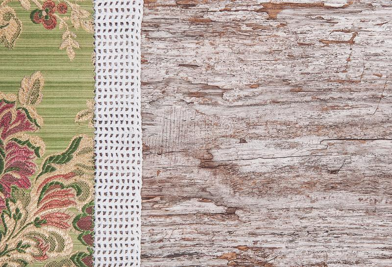 Floral fabric and lace on old wood background. Floral fabric and lace on the old wood background royalty free stock photography