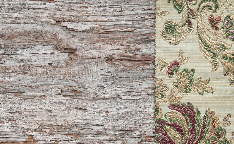 Floral fabric and lace on old wood background. Floral fabric and lace on the old wood background royalty free stock photos