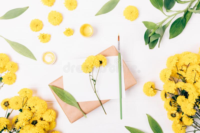 Floral flat lay composition of gouache paint stock photo