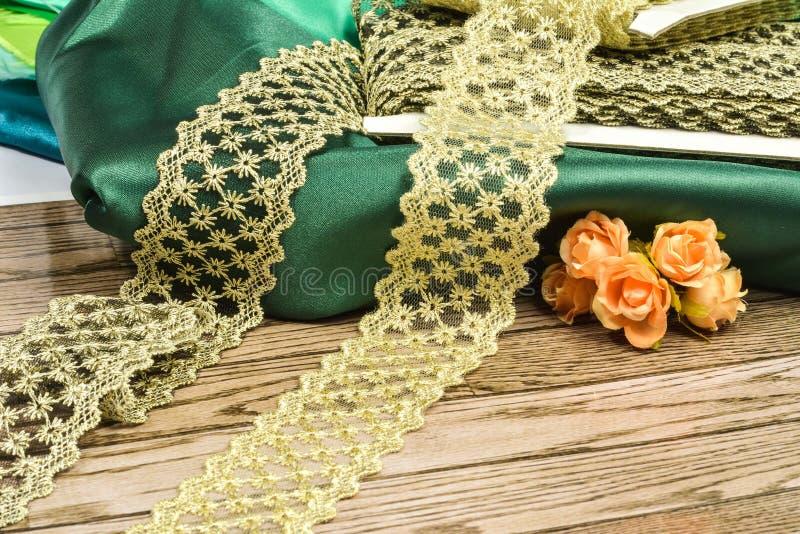 Golden rills background on green silk stock photo