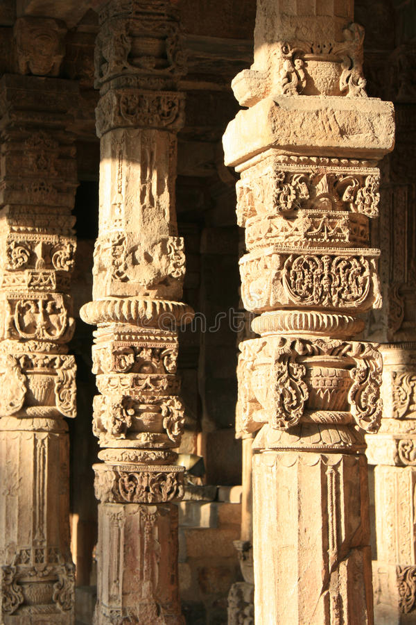 Floral and geometrical patterns were sculptured on the pillars of a gallery at Qutb minar in New Delhi (India) royalty free stock photos